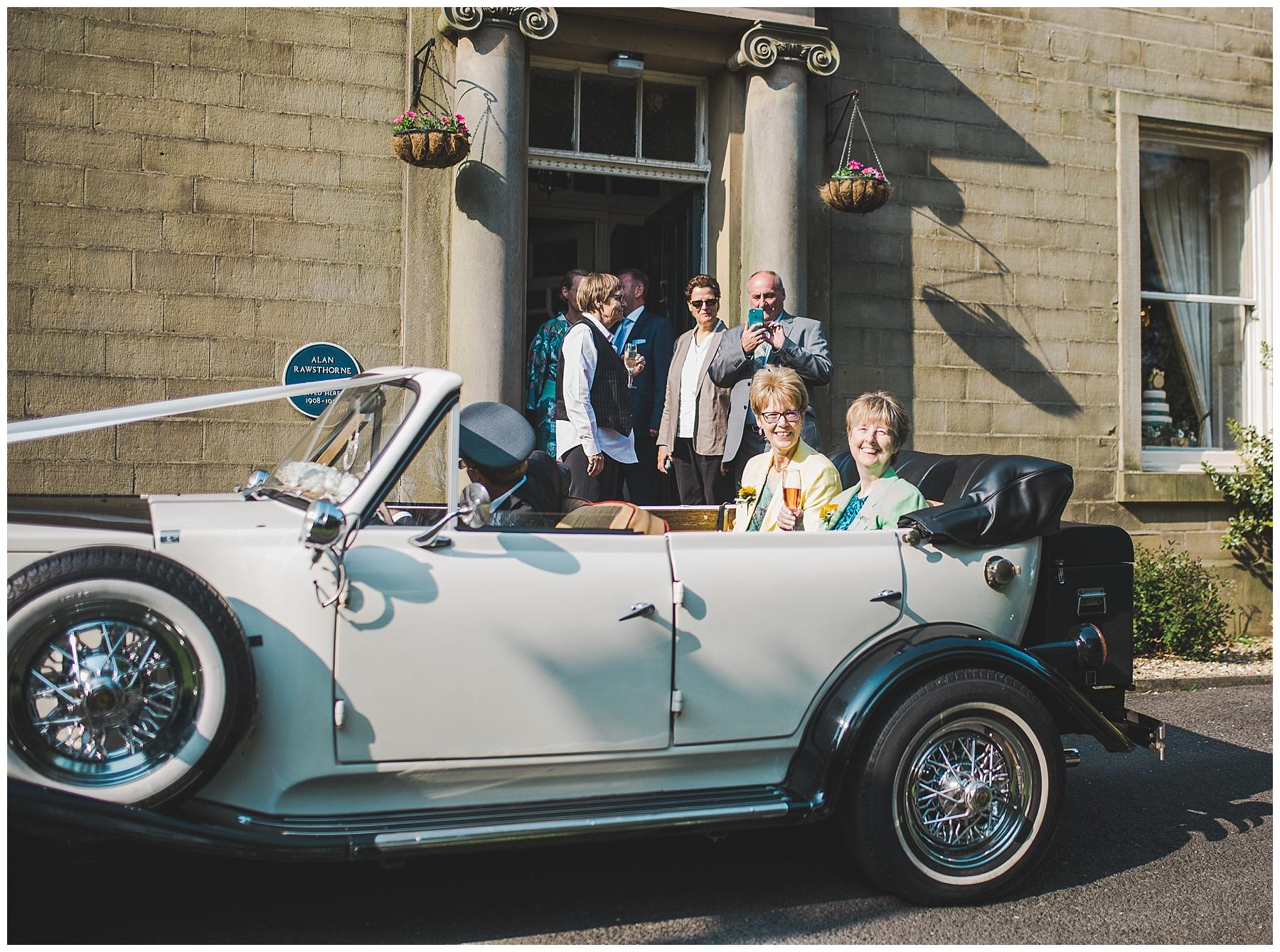 Bride and Bride in the wedding car - sykeside hotel haslingden