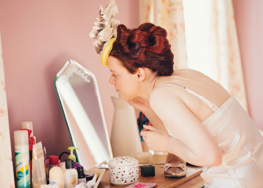 bride putting her make up on - lancashire wedding photographer