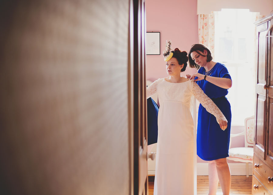 bride getting dressed - wedding photography Lancashire