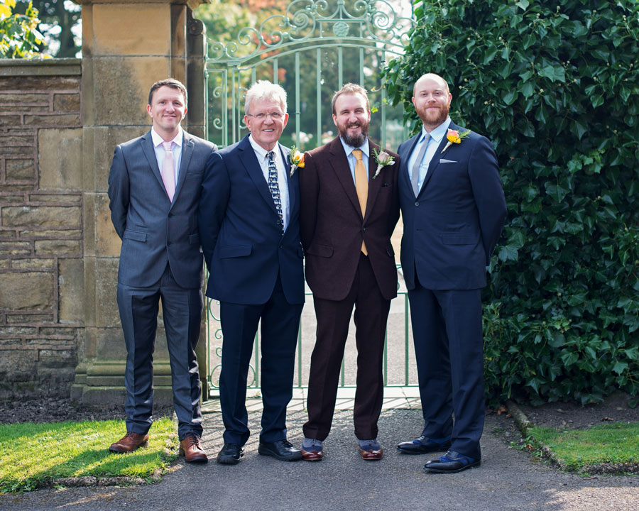 groom with groomsmen outside the haworth art gallery
