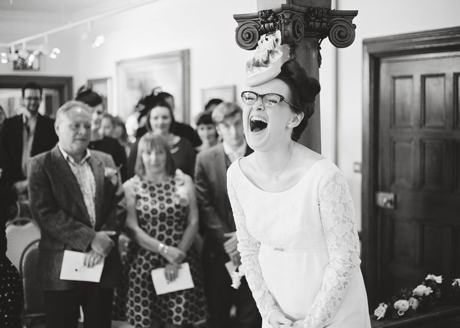 bride laughing during ceremony - documentary style images in Lancashire