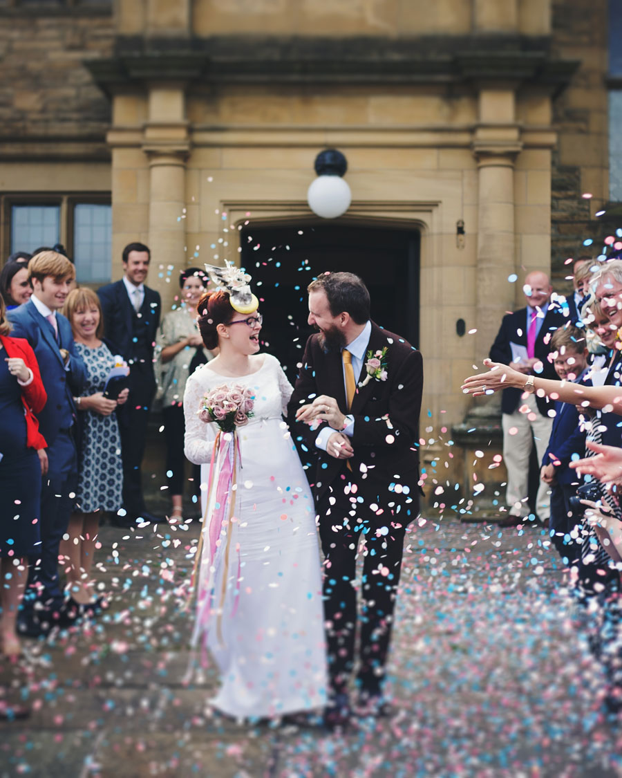 the confetti shot - bride and groom outside haworth art gallery