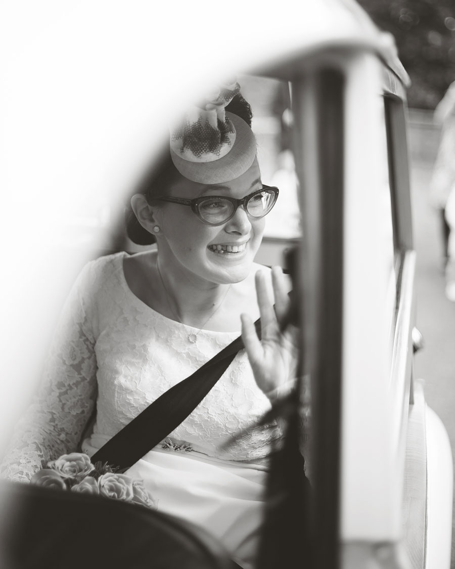 bride in car leaving ceremony