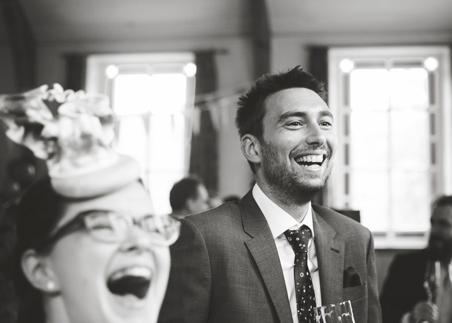 guest and bride laughing - documentary wedding images in lancashire