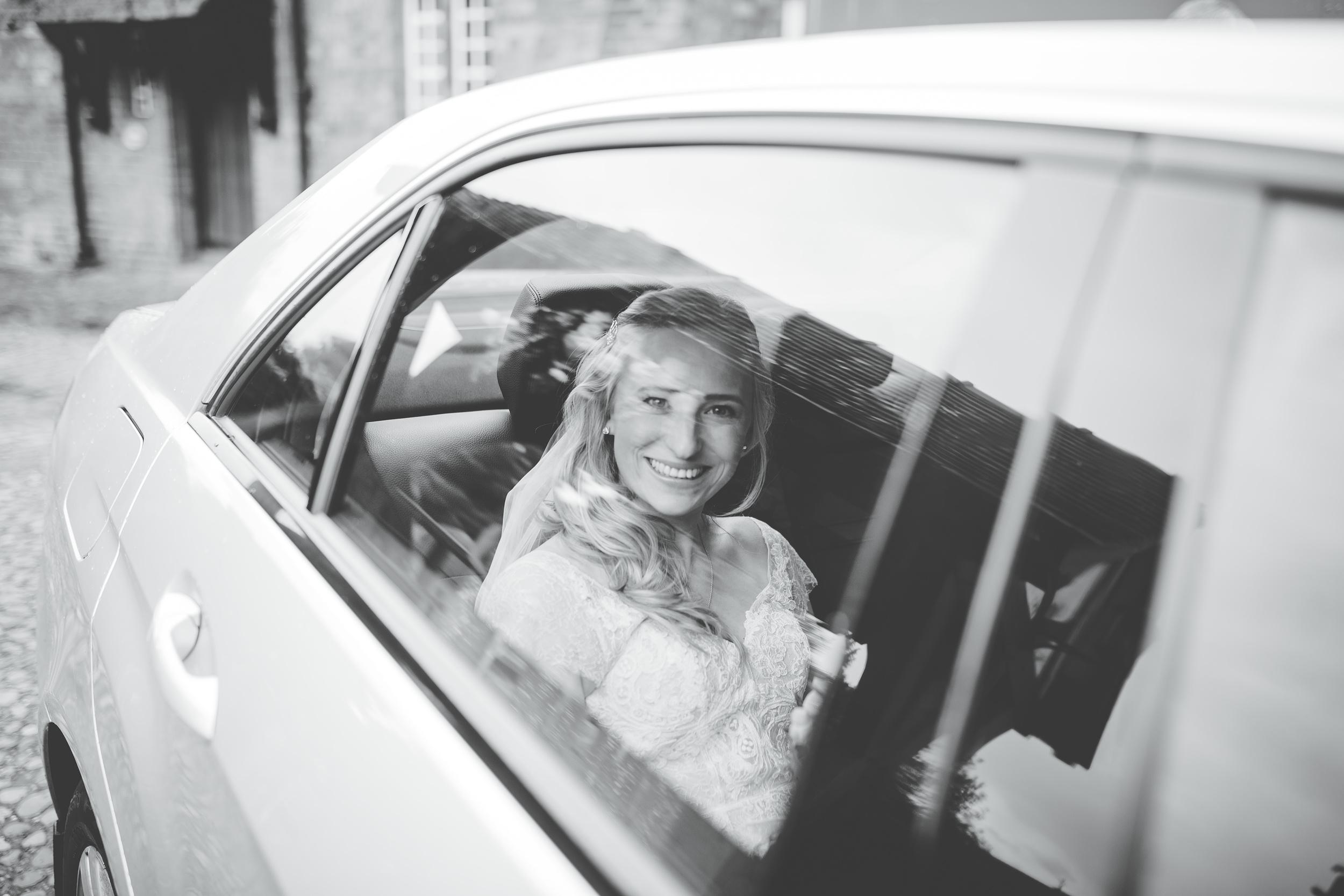 Cheshire wedding photographer - bride arrives at church