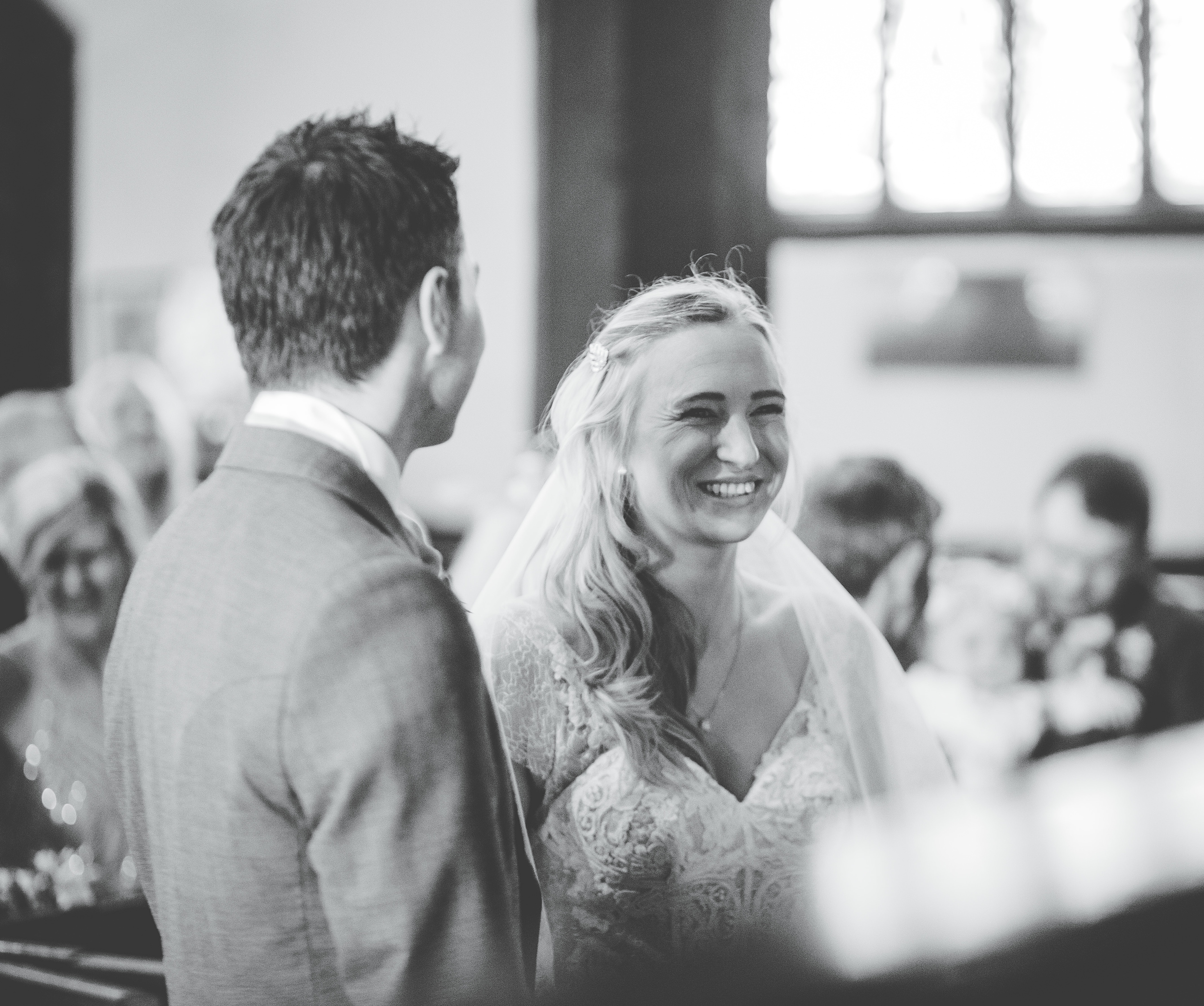 bride laughs during the church ceremony