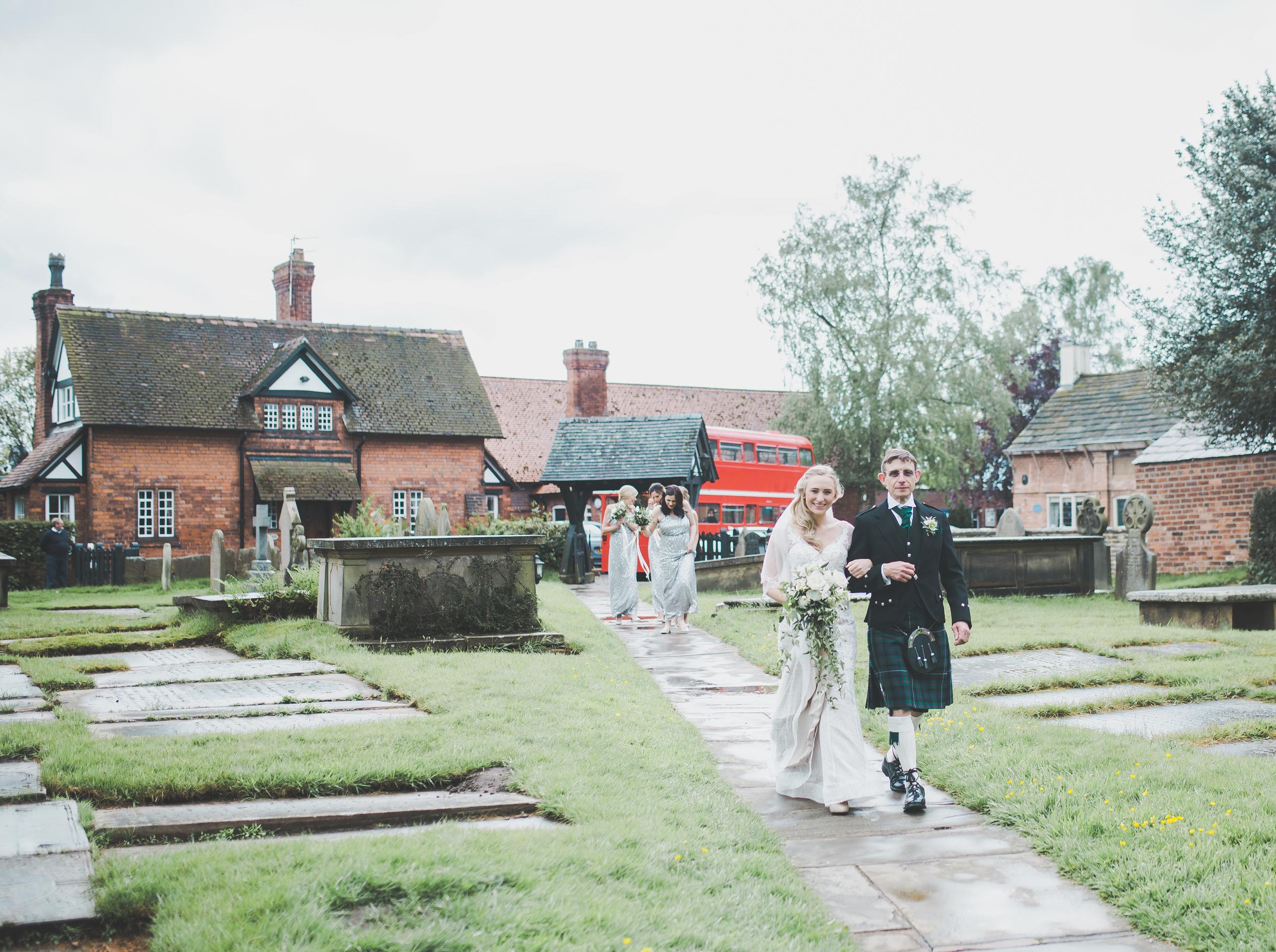 Cheshire wedding photography - bride walks to church