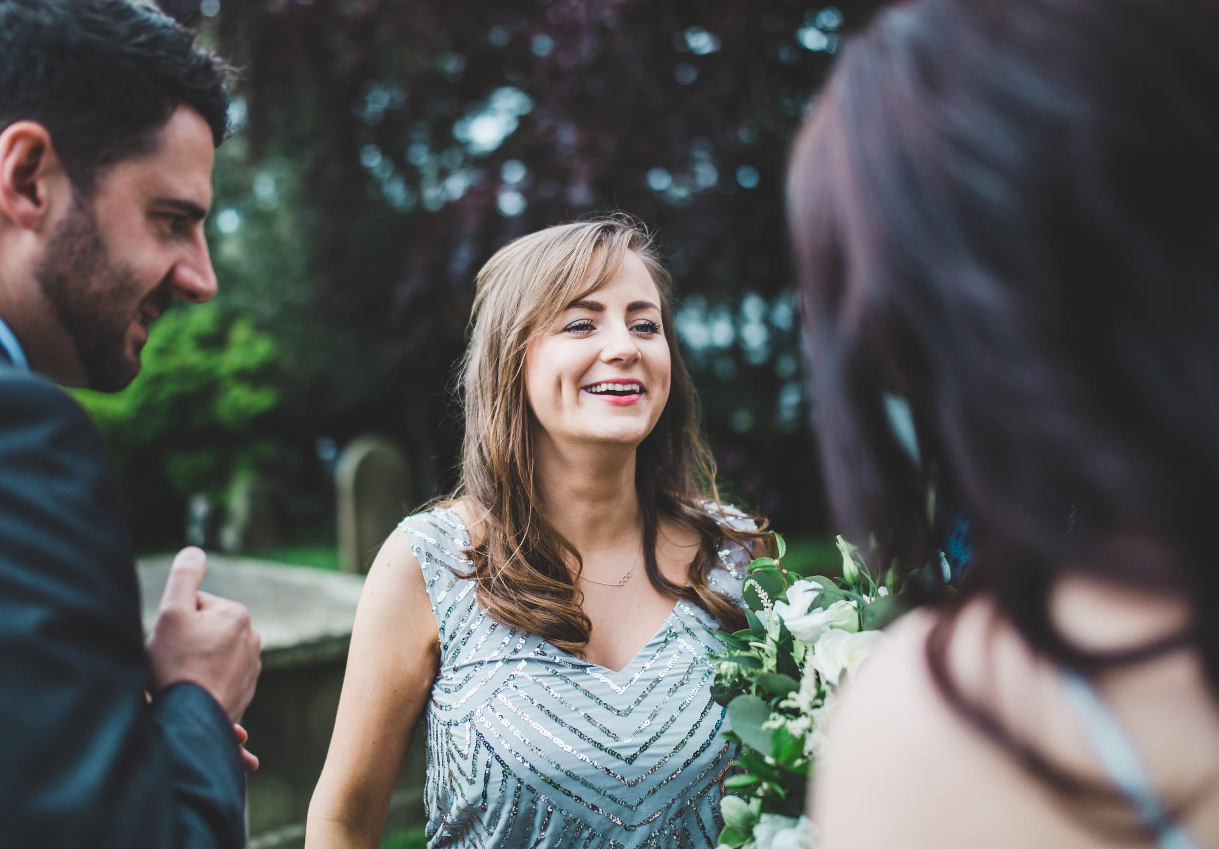 documentary wedding photography Cheshire - bridesmaid outside church