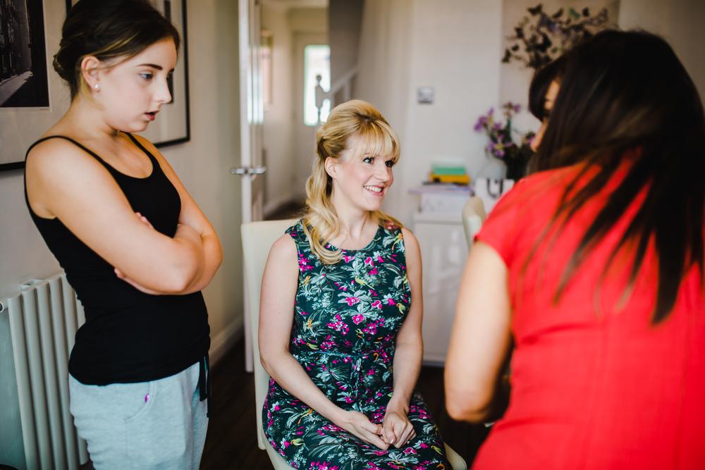 bride having make up done - lancashire wedding photographer