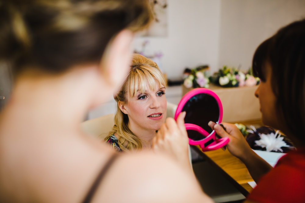 close up image of the bride getting ready