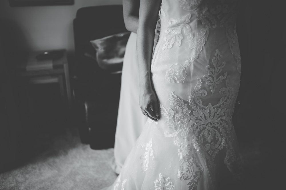 bride getting dressed - creative wedding pictures