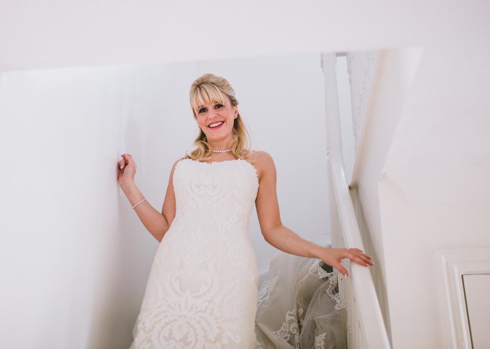 bride walking down the stairs at lancashire wedding