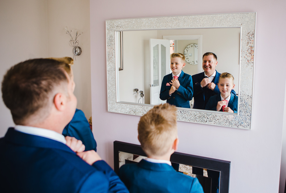 groom and sons together in the mirror - full day wedding photography in lancashire