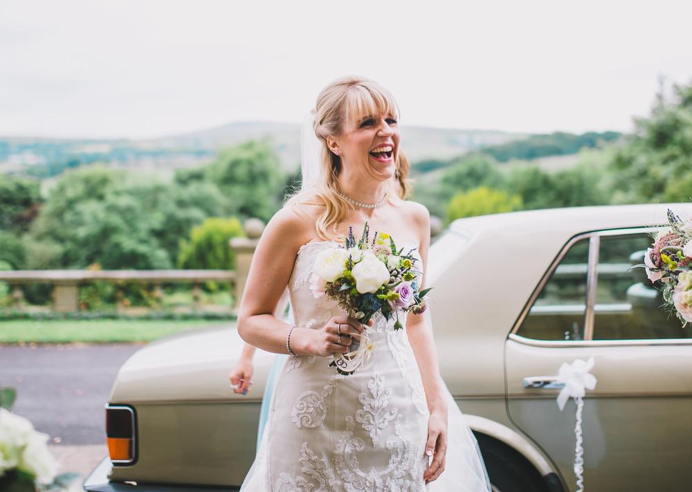 bride outside the haworth art gallery - lancashire wedding photographer