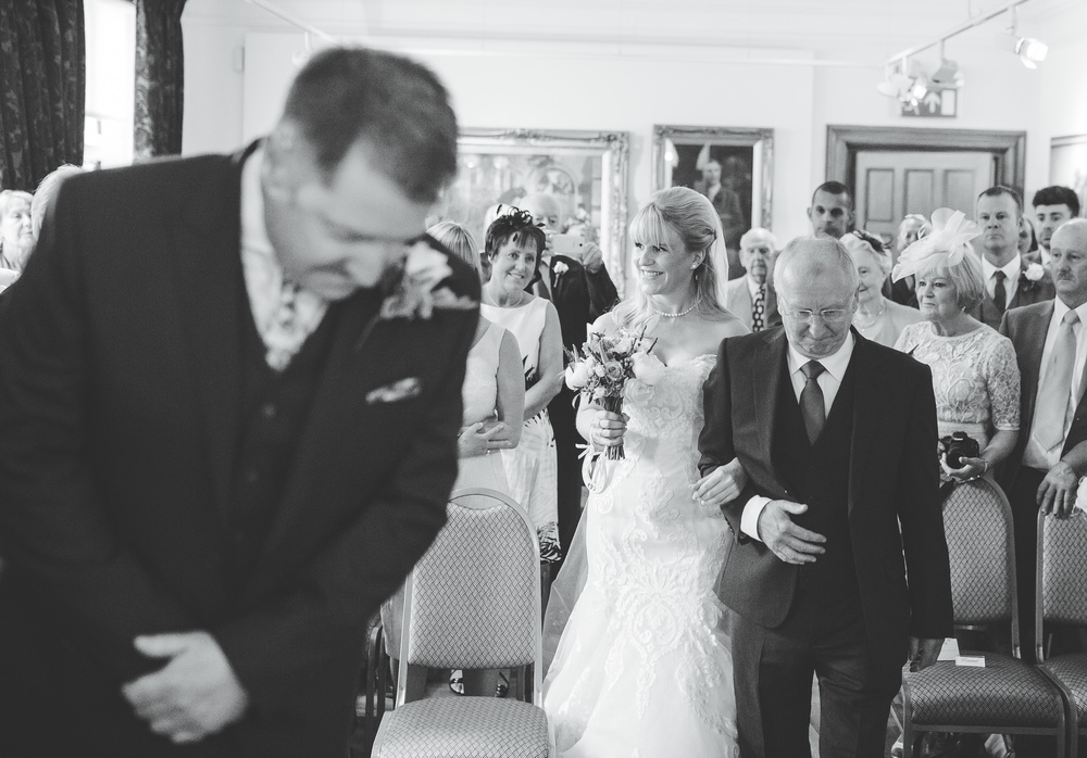 bride walking up the aisle with father