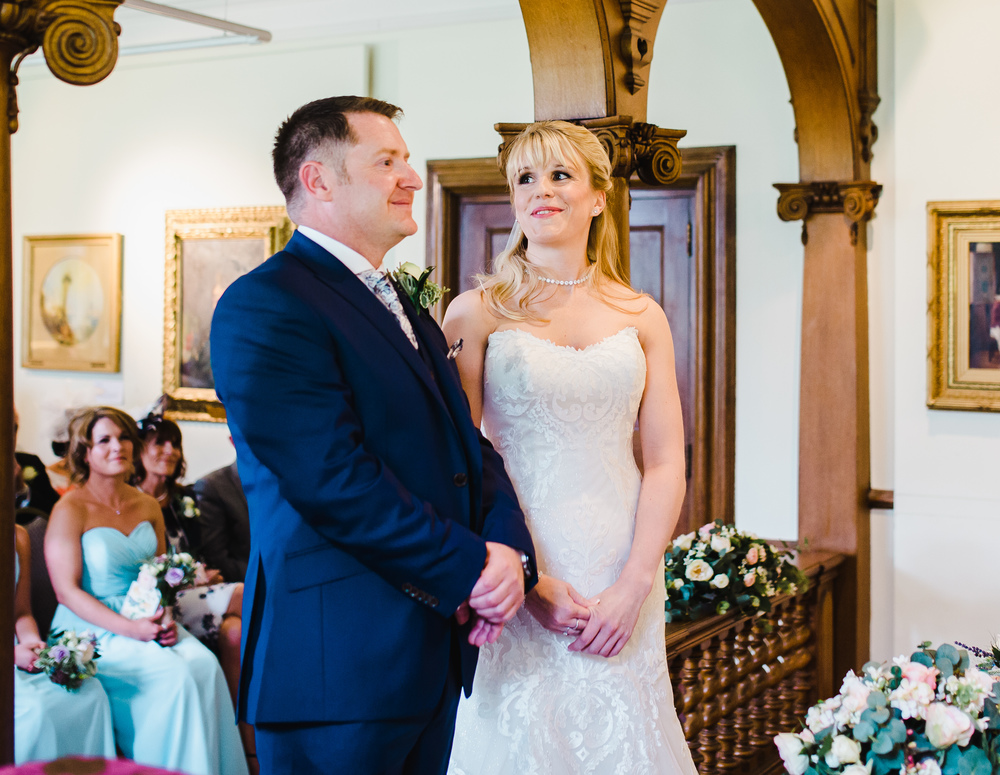 bride and groom in the music room at haworth art gallery
