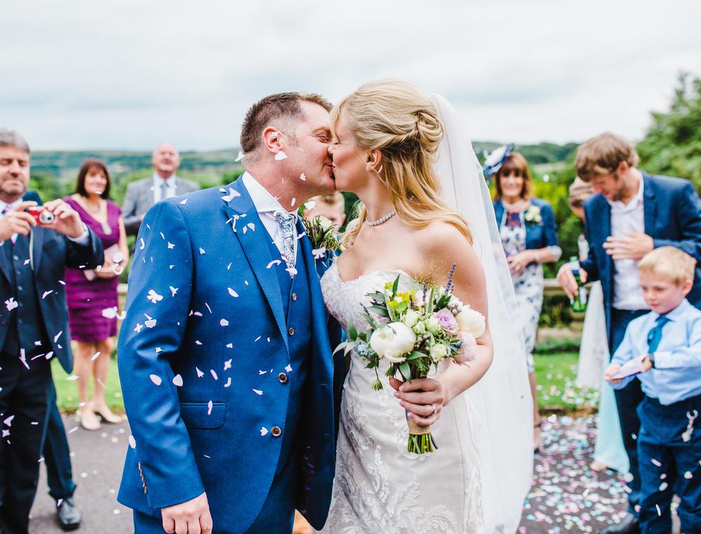 bride and groom kiss - outside haworth art gallery