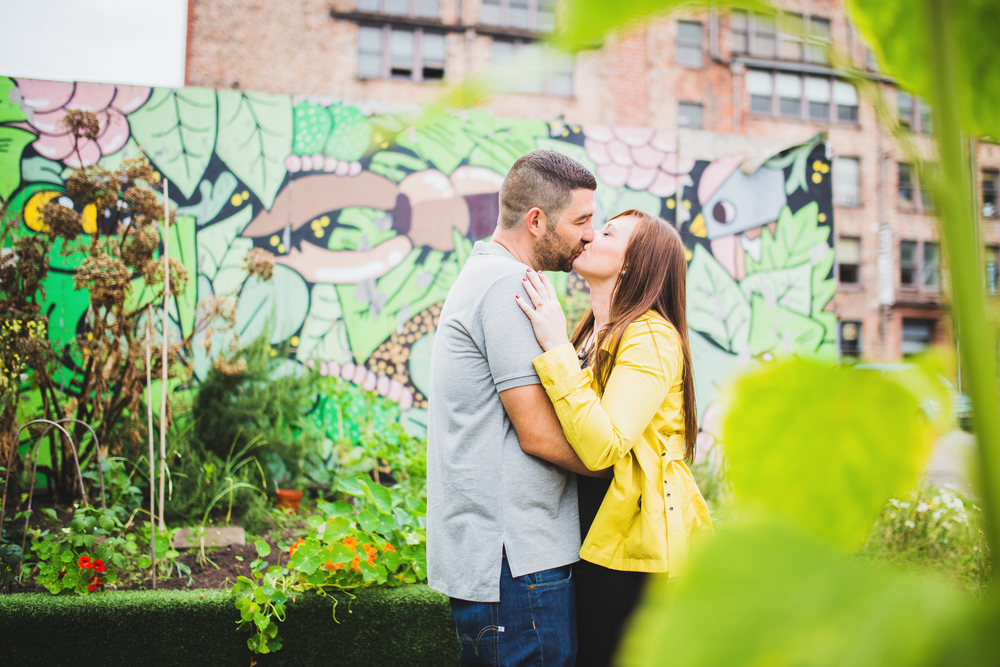 couple in front of graffiti in manchester city centre