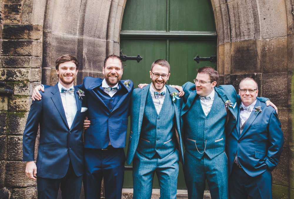 Cheshire wedding photographer - Smiles from the groom and groomsmen.
