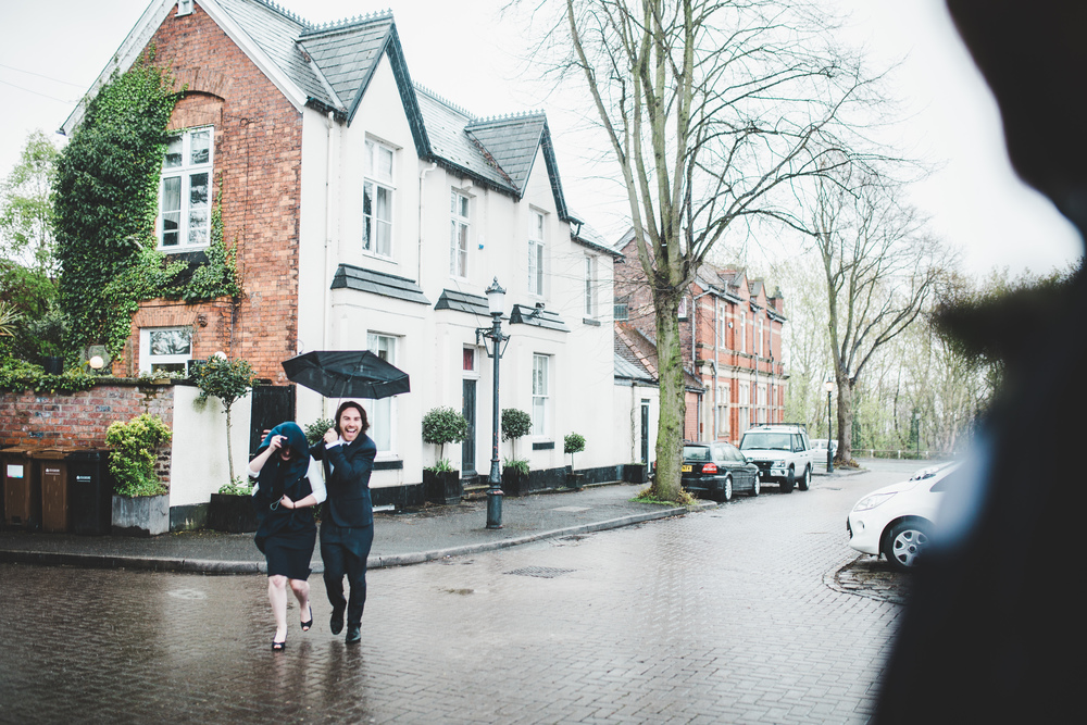 Umbrellas at the ready for the Cheshire wedding- documentary wedding images