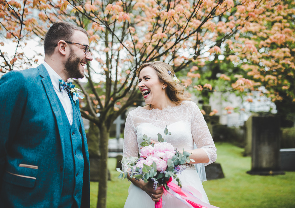 documentary wedding photography - laughing outside church