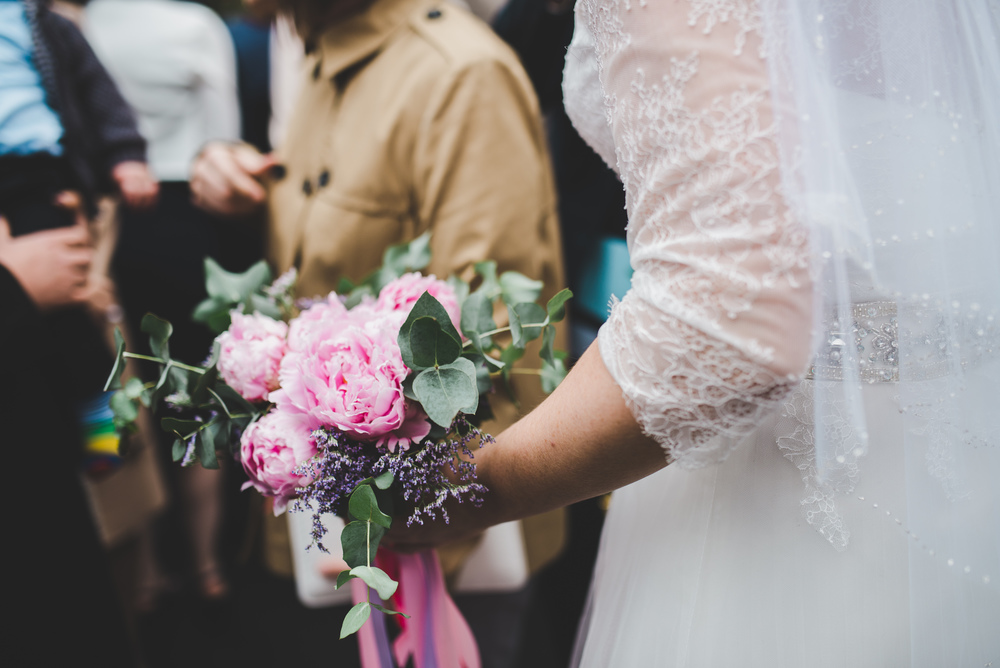 A bouquet of flowers held by the beautiful bride.