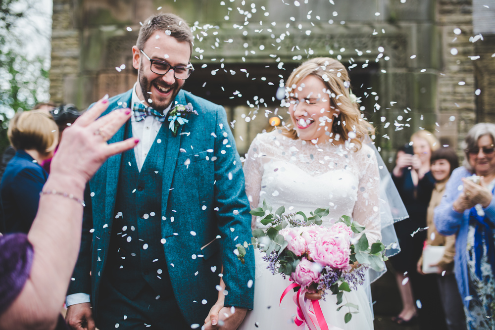 Confetti in air for the bride and groom in Cheshire.