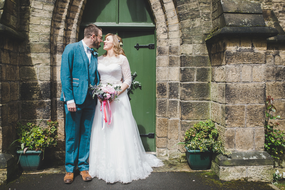 Wedding Photographer in cheshire - bride and groom portraits outside the church