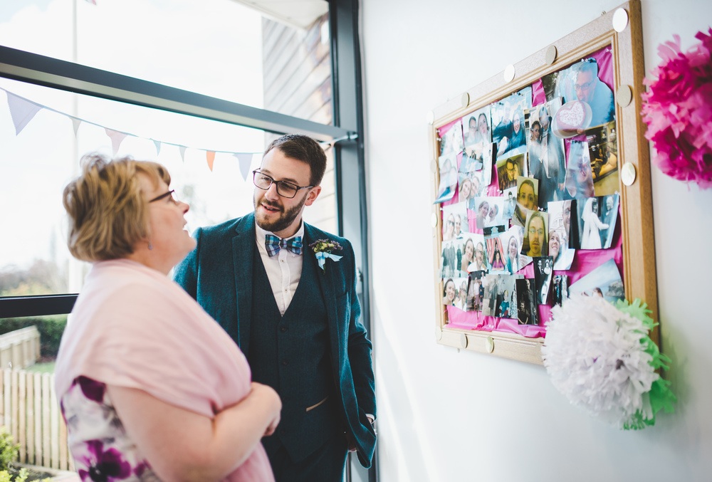 bride and his mum - looking at the wedding decor