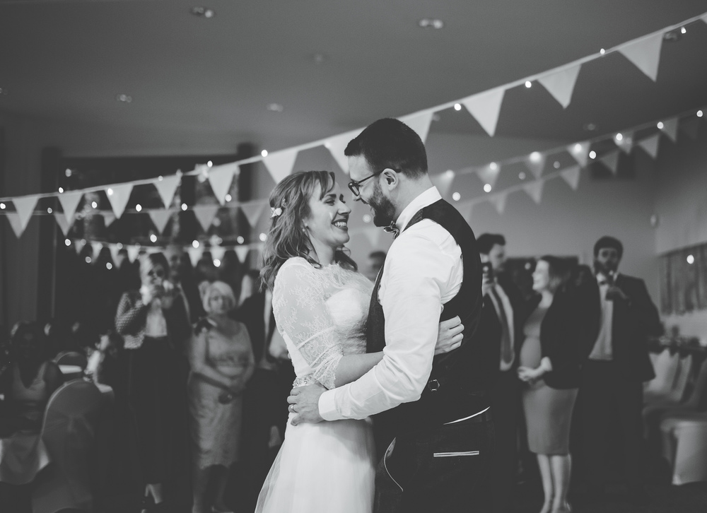 Black and White photograph of the bride and grooms first dance.