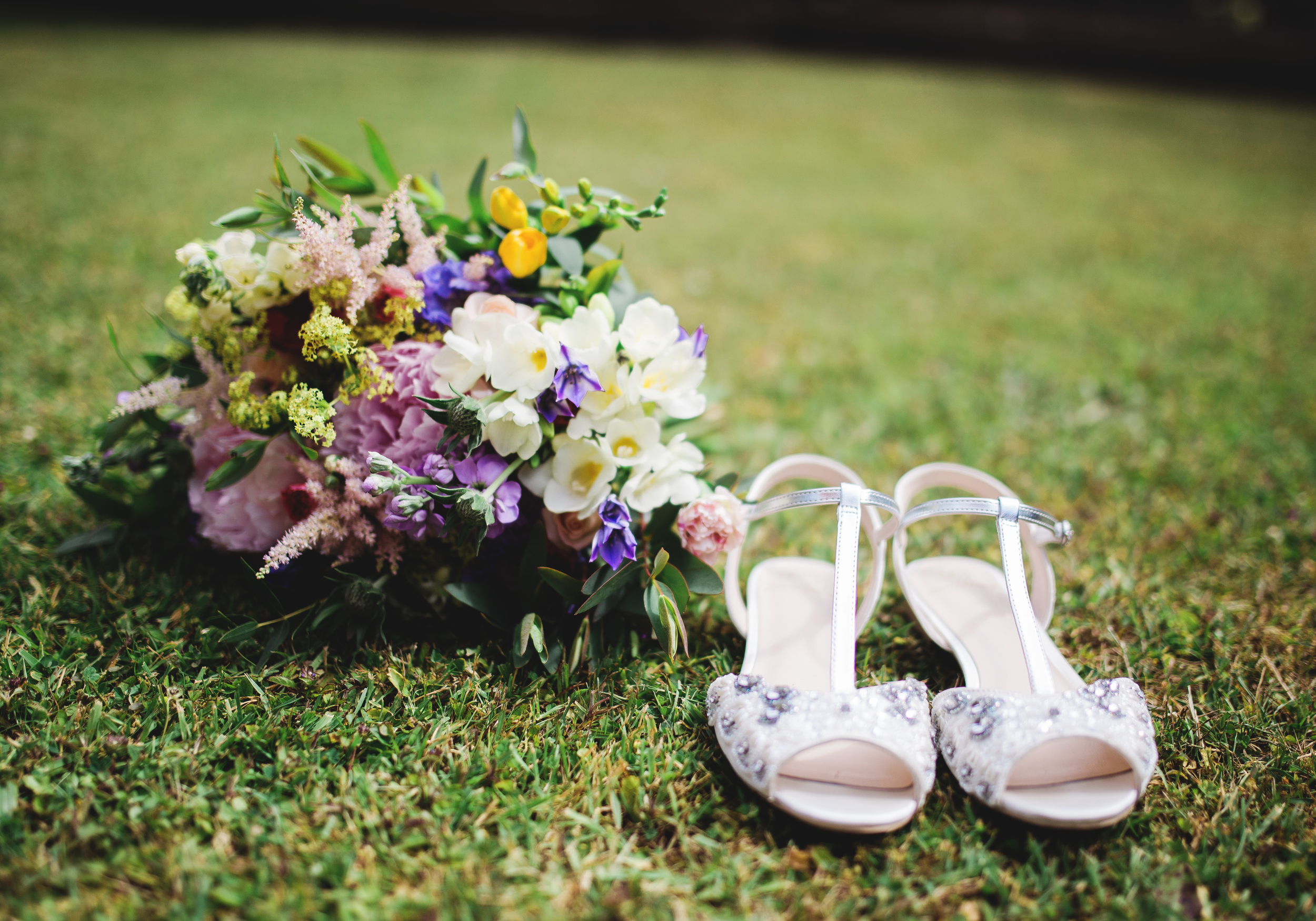 brides shoes and flowers - southport wedding photographer