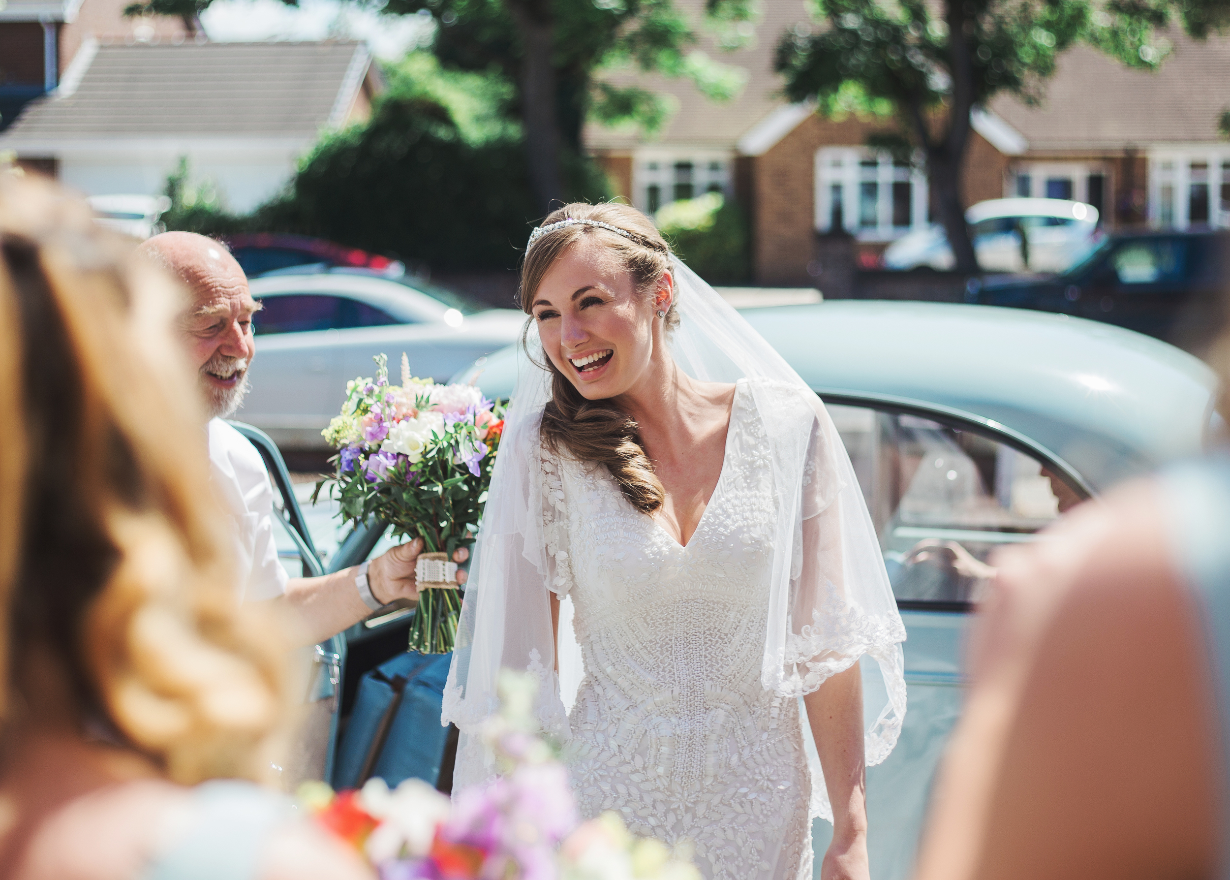 Bride laughs as she arrives at church - Southport Wedding Photography