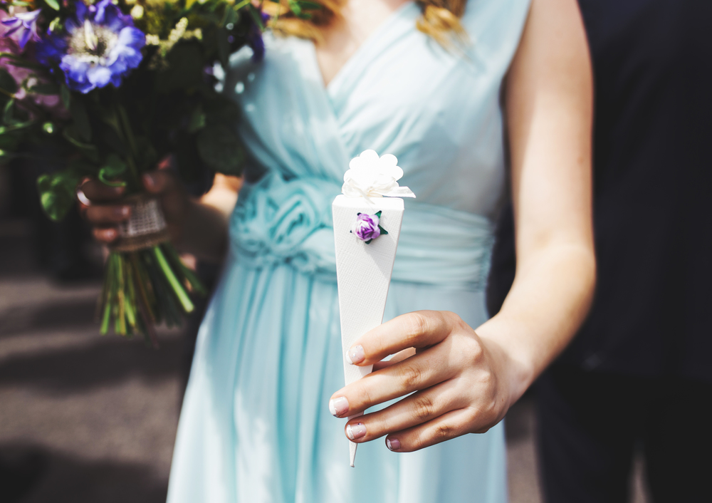 Bridesmaid holding the flowers-Lancashire wedding photographer.