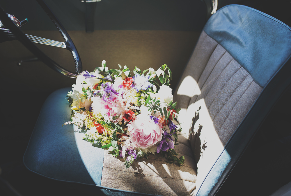Creative wedding images in Lancashire - flowers in car