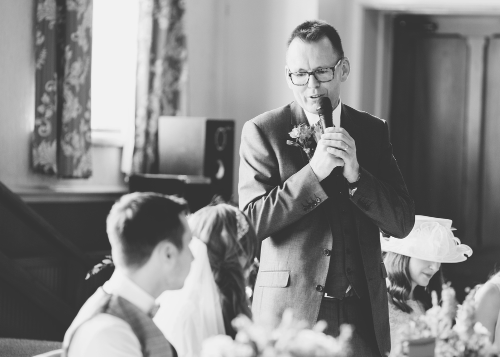Black and white documentary photograph of the speeches. -Lancashire wedding photographer.