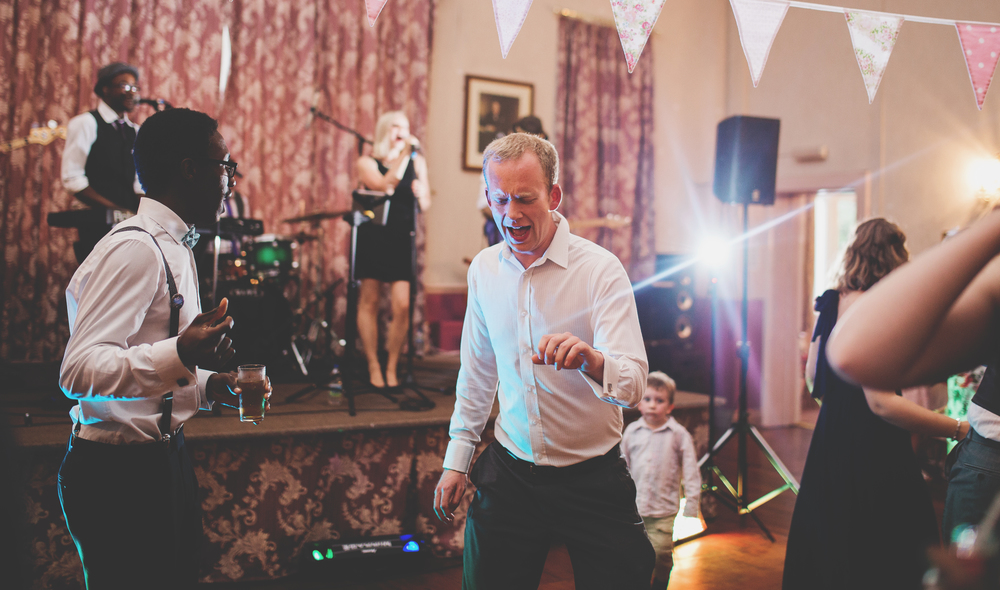 Guest dancing at village hall wedding in Southport - full day wedding coverage in Lancashire
