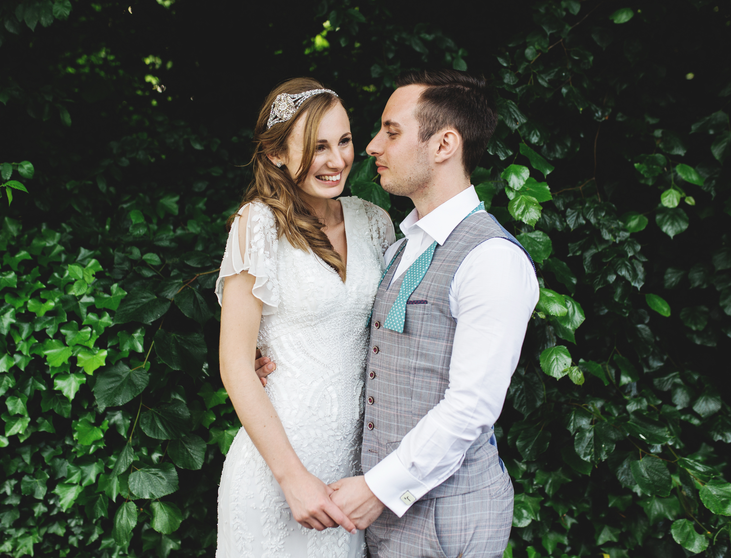 Creative wedding photography - bride and groom at Rainford Village Hall