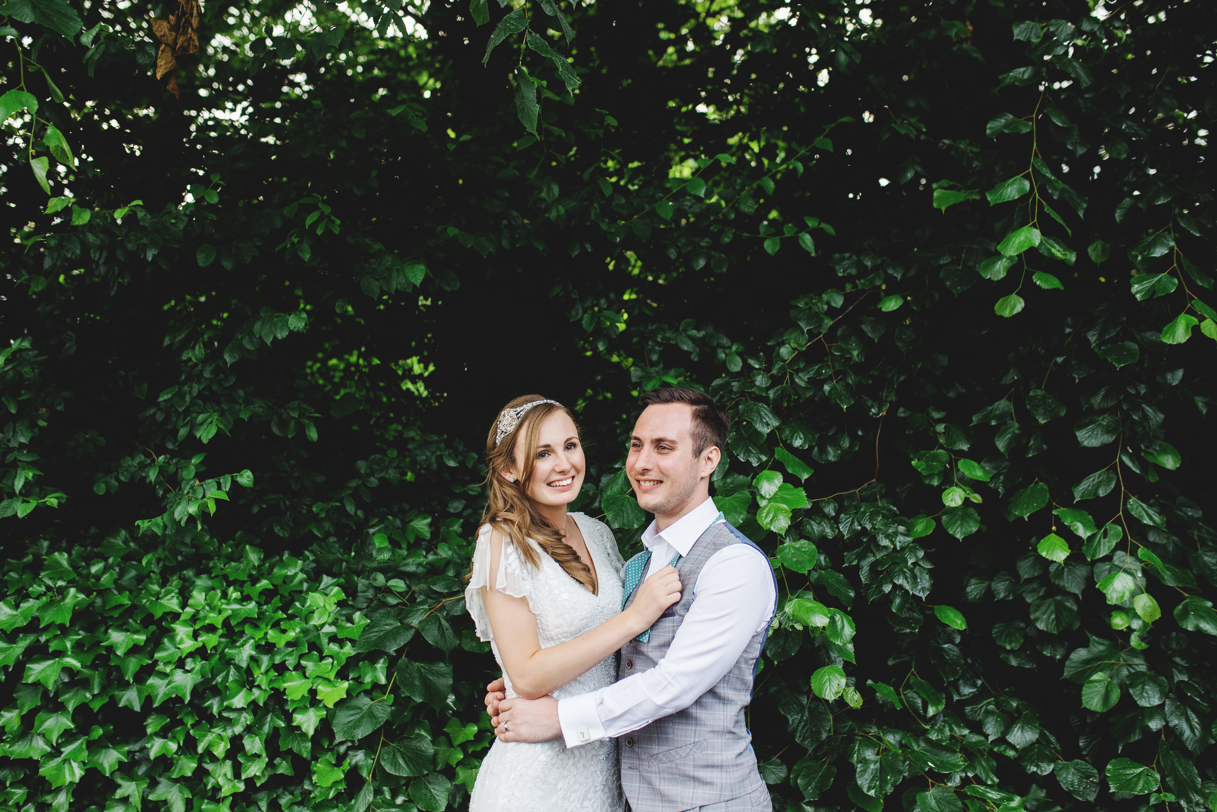 stylish wedding pictures - bride and groom outside Rainford Village Hall