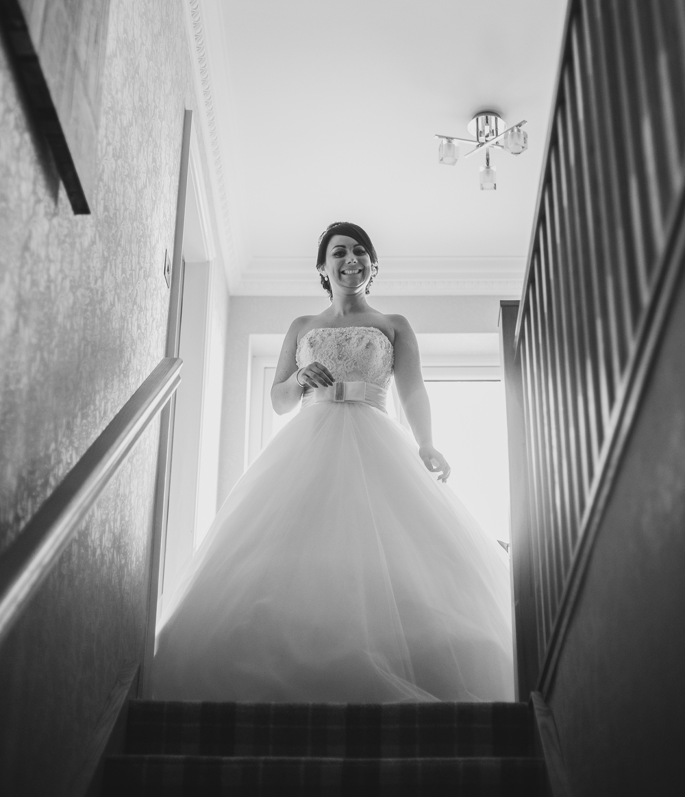 Lancashire wedding photographer - bride coming down the stairs