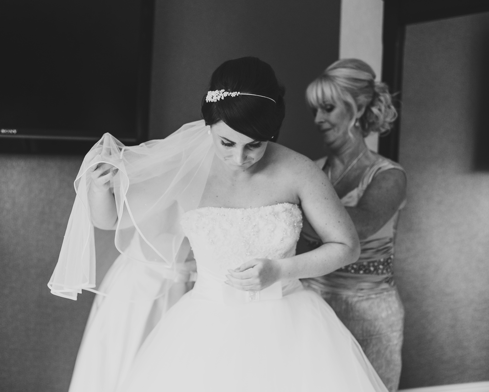 Black and white photograph of the bride getting ready - lancashire wedding photographer