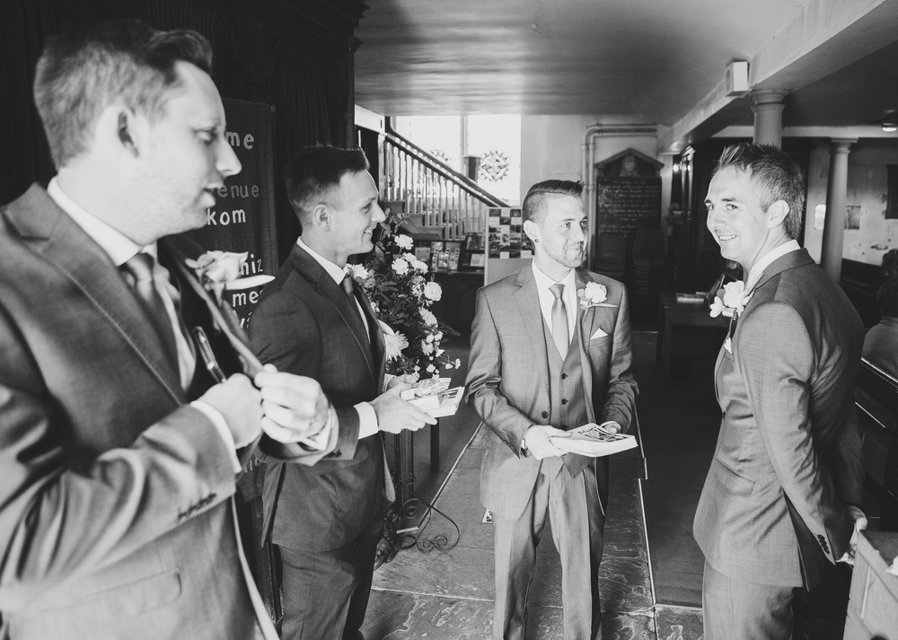 Black and white photograph of the groom and his men - wedding photography in lancashire