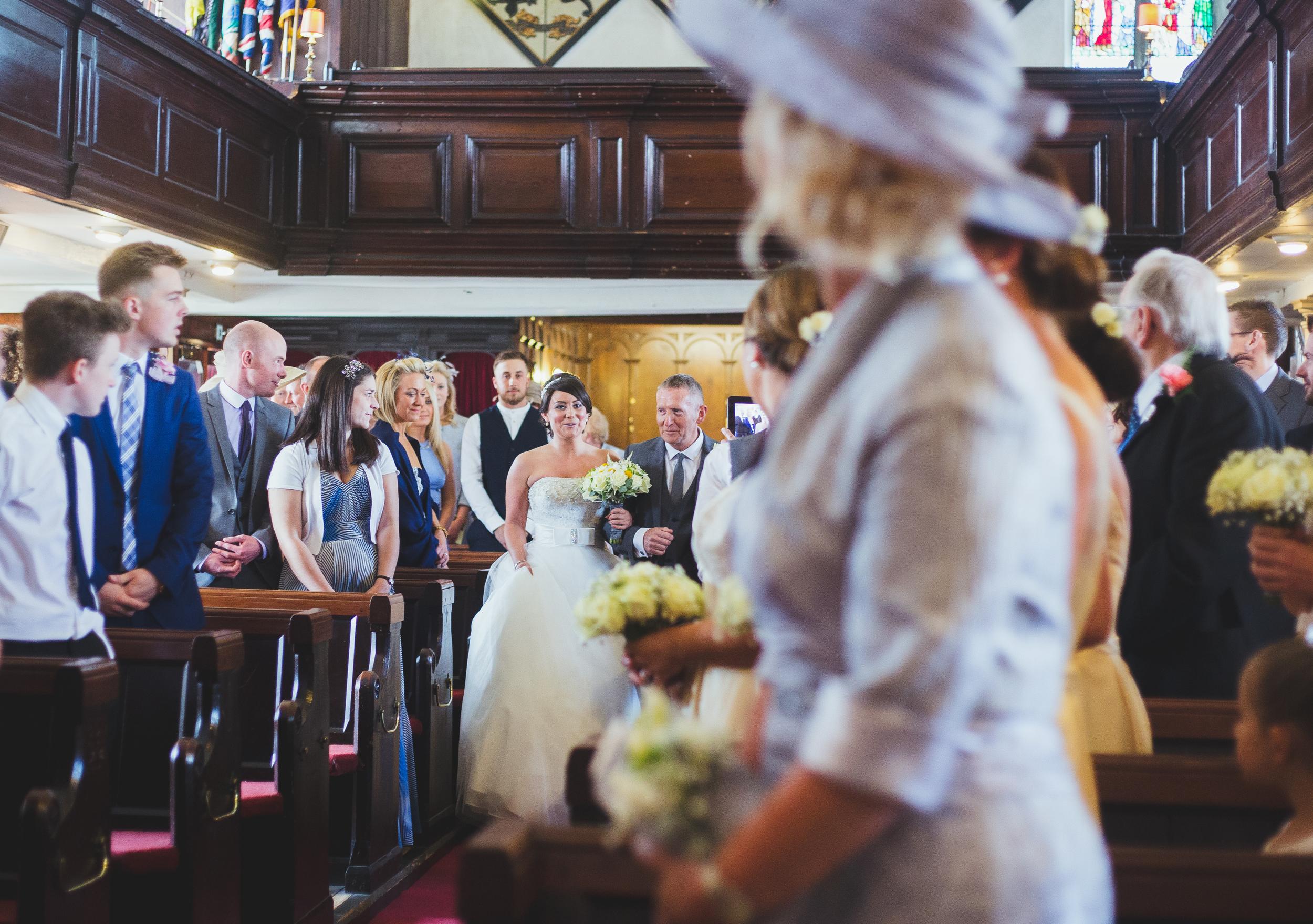 bride walks down the aisle - wedding photographer Lancashire