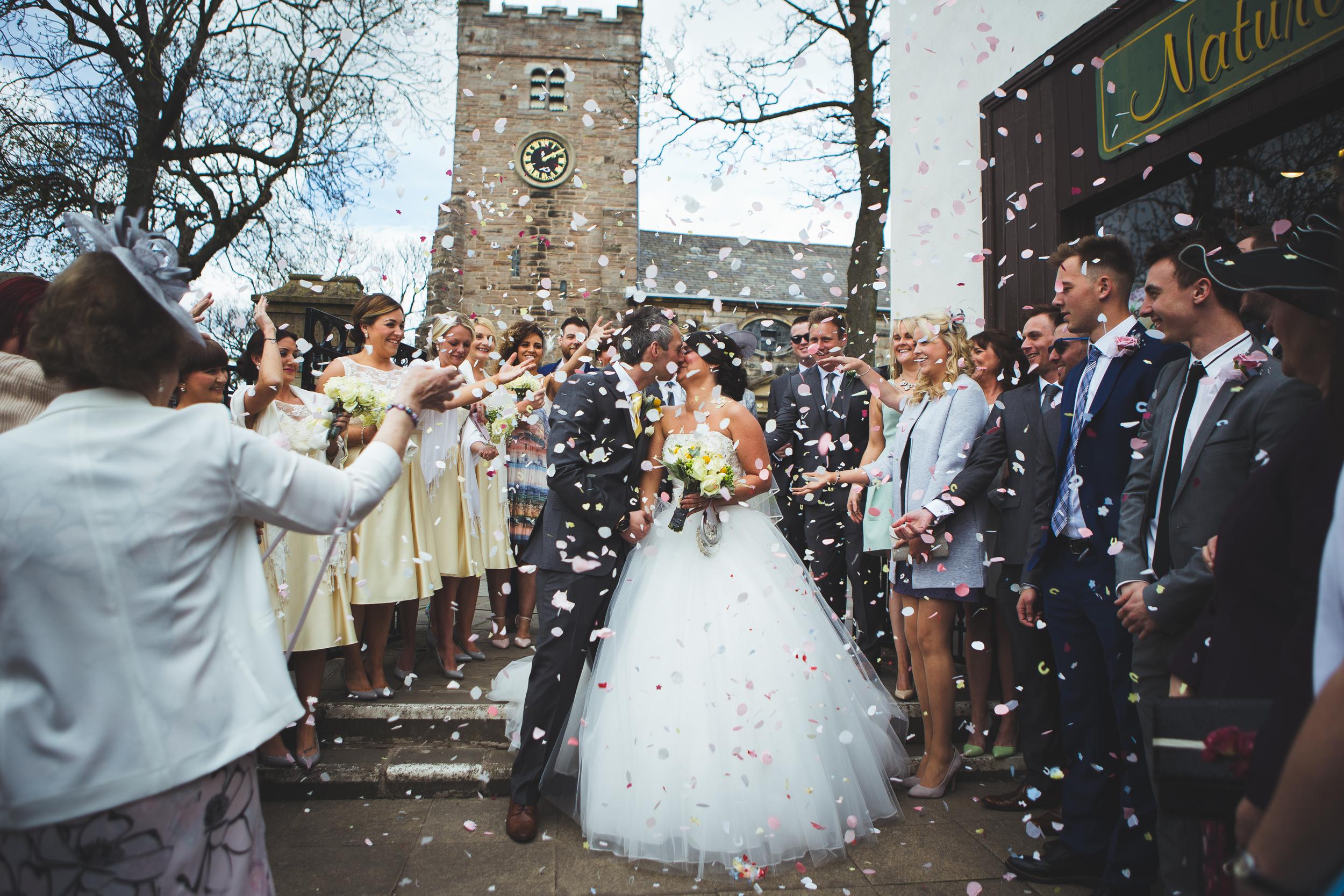 Lancashire wedding photographer - confetti outside church