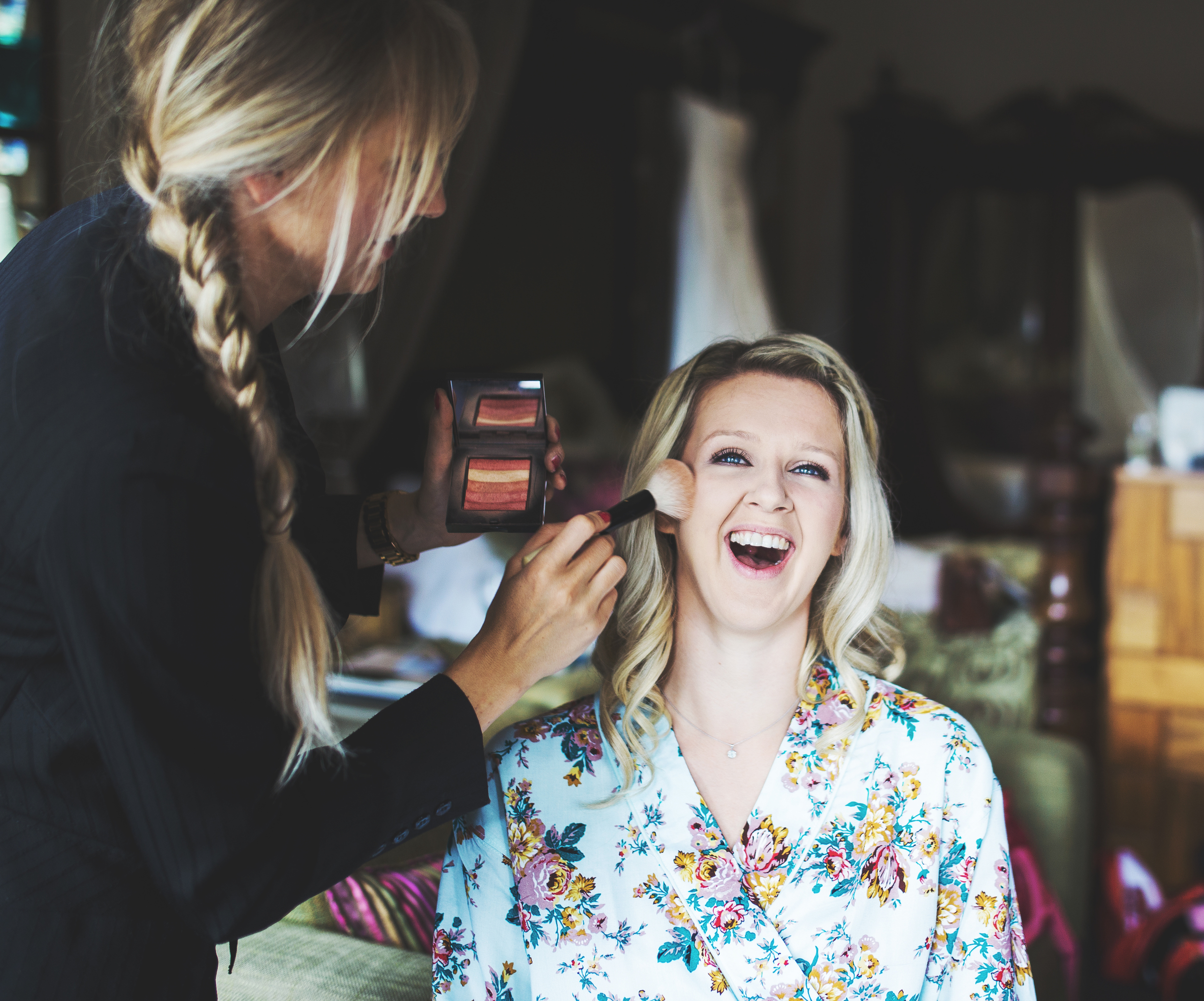 make up getting done - smiling bride