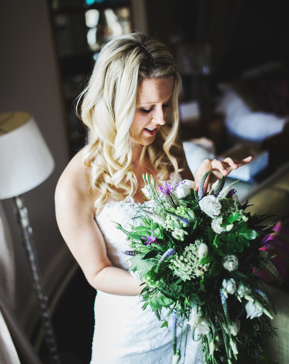 Bride with her bouquet of flowers in her hand.