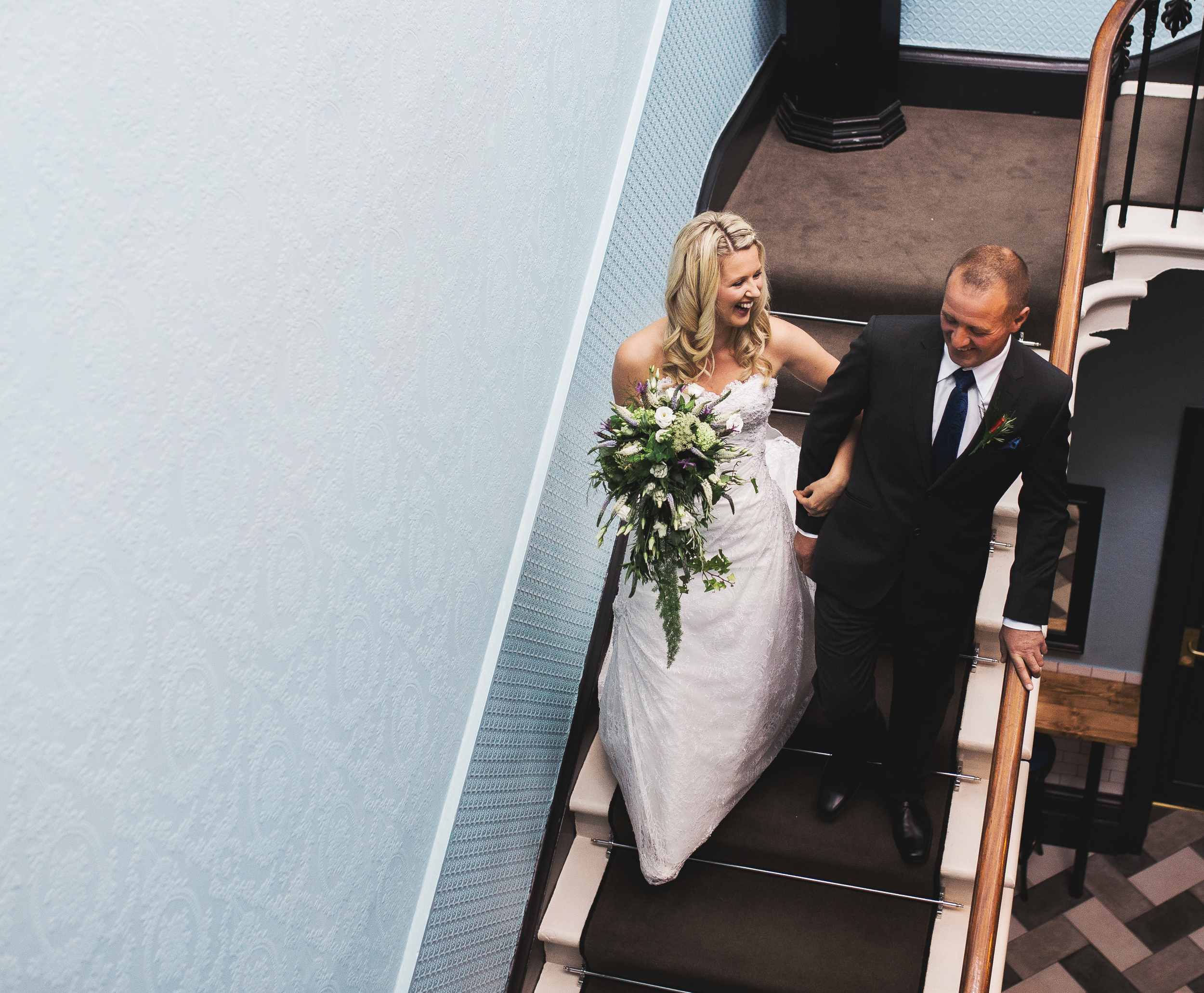 walking down the stairs - Churchill Hotel wedding pictures