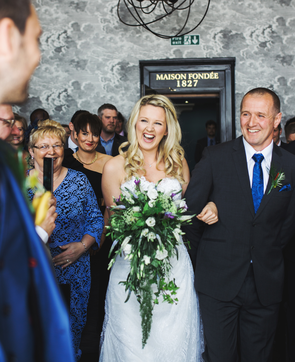 Smiles from the bride as she walks down the aisle.