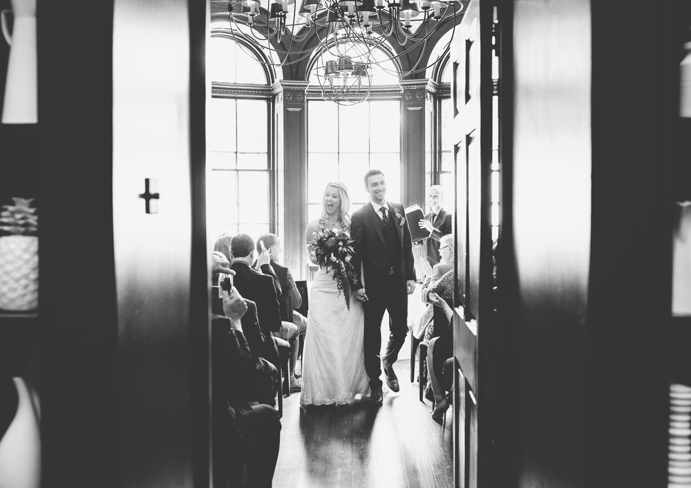 bride and groom leaving the ceremony at churchill hotel wedding