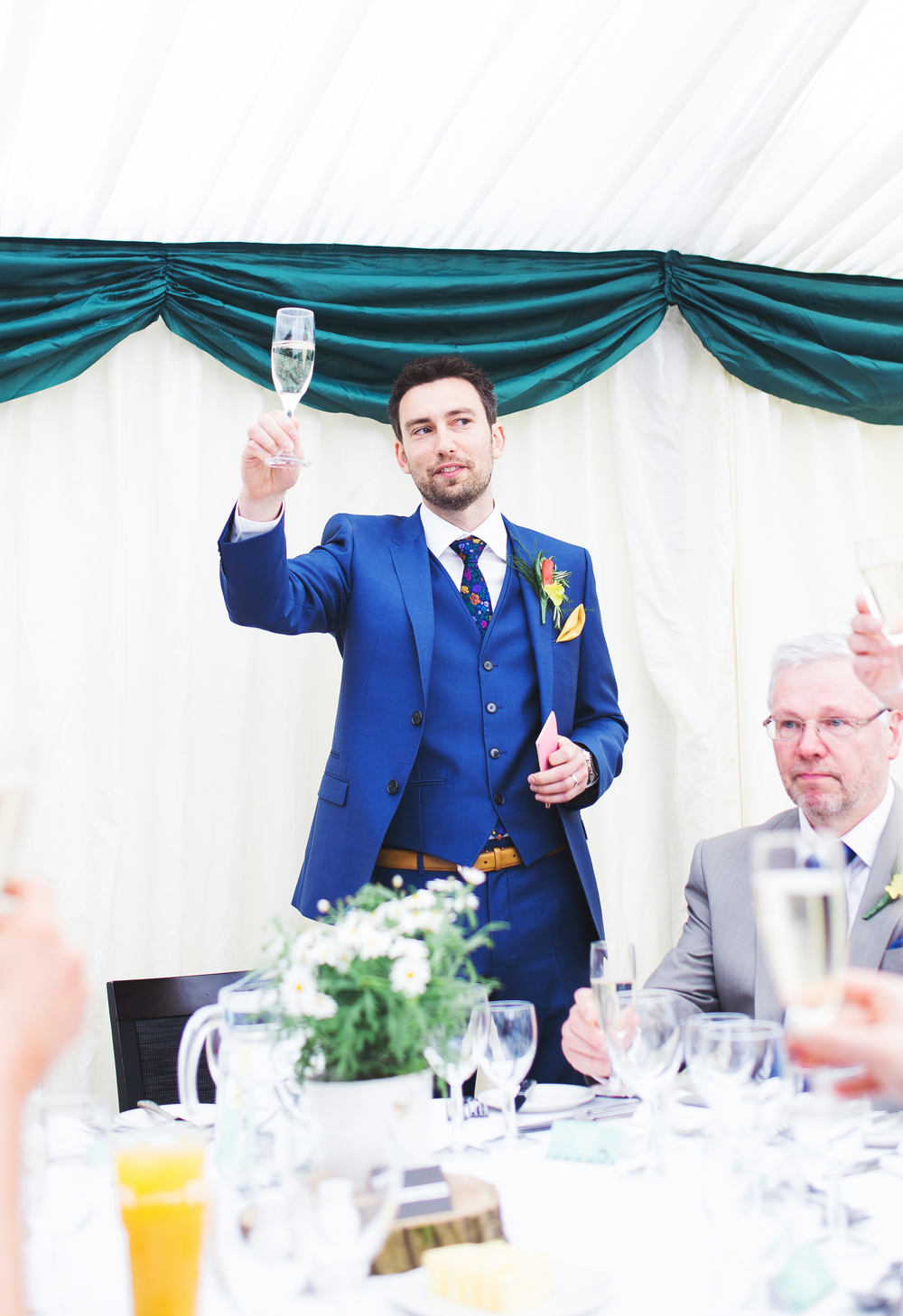 Cheers from the groom.