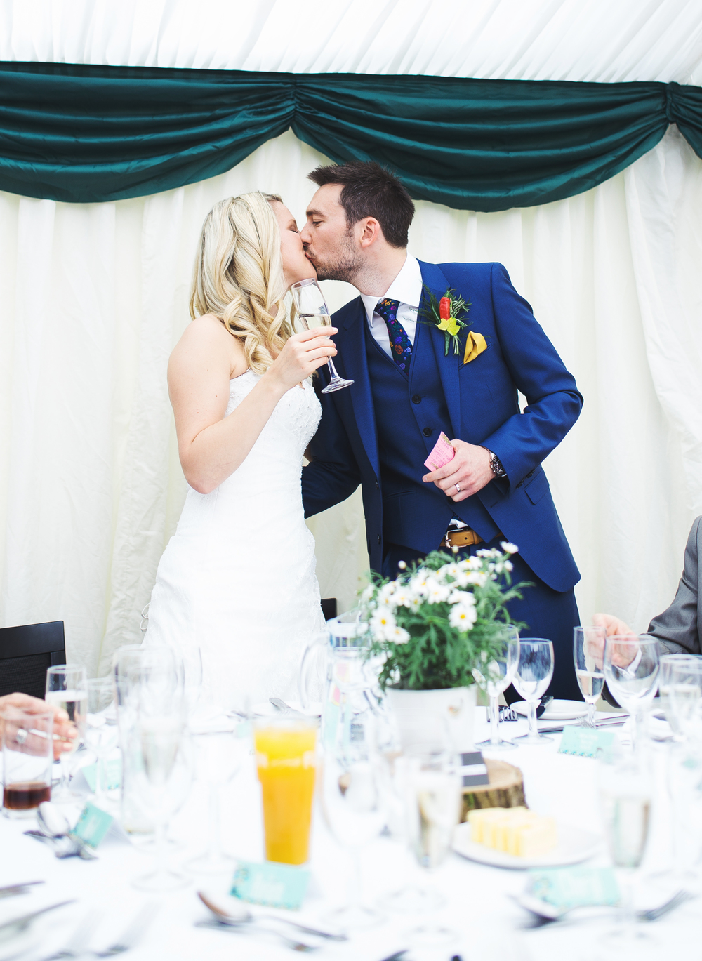 The bride and groom share a kiss.